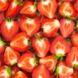 Fresh sliced strawberries summer background - Stock fotografie