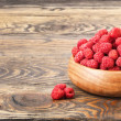 Raspberry on wood background selective focus — ストック写真