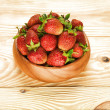 Strawberry on wood background selective focus - Stock fotografie