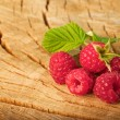 Raspberry on wood background selective focus - Stock Photo