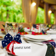 Blank event Guest Card on restaurant table with american flag — Stock Photo