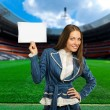 Soccer, woman on playing field showing information - Stock Photo