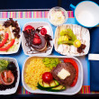 Stock Photo: Tray of food on the plane, business class travel
