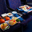 Tray of food on the plane — Stock fotografie