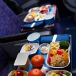 Tray of food on the plane, business class travel — Stock Photo