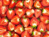 Färska skivade jordgubbar sommar bakgrund — Stockfoto