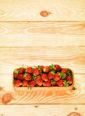 Strawberry on wood background selective focus. Fresh organic food. — Stock Photo
