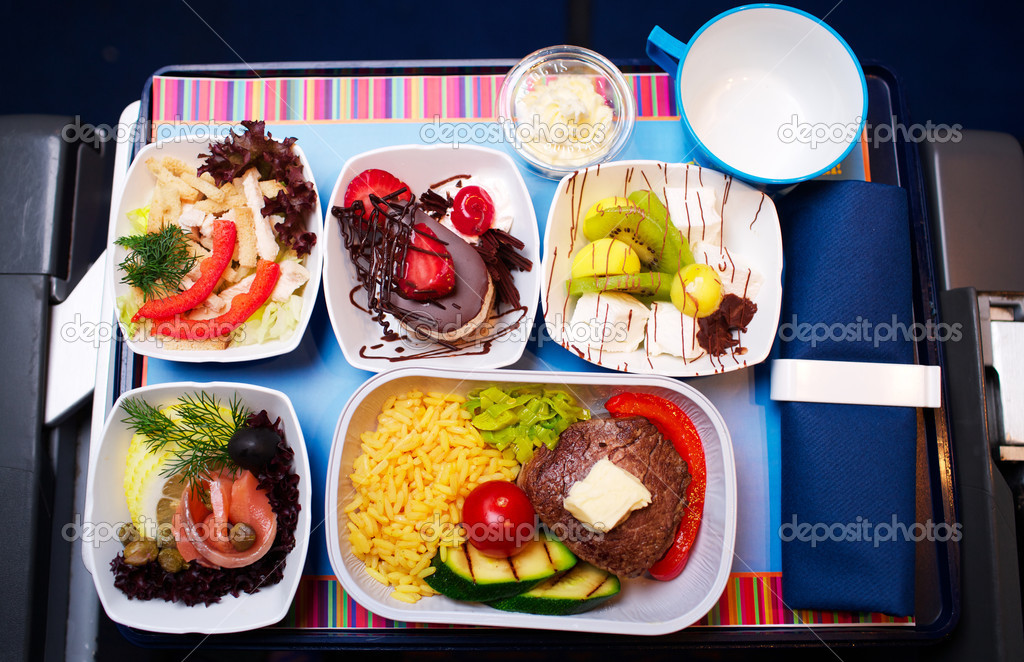 Tray of food on the plane, business class travel  Stock Photo #11375931