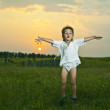 heerful little boy playing on the grass - Stock Photo