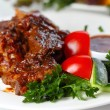 Delicious beef goulash with greens and vegetables - Stock Photo