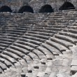 Ruins of ancient theater. Seats and arches. — Stock Photo #11260108