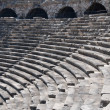 Ruins of ancient theater. Seats and arches. — Stock Photo