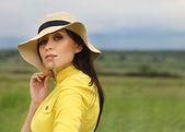 Brunette girl in hat in summer day — Stock Photo