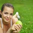 Beautiful young girl with green apple — Stock Photo