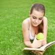 Beautiful young girl reading in summer park — Stock Photo #11367771