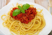 Spaghetti Bolognese on white plate — Stock Photo