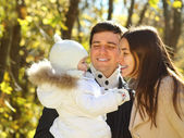 Family with daughter in autumn park — Stock Photo