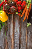 Vegetables still life in wooden background — Stock Photo