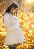 Happy pregnant woman in the autumn park — Stock Photo