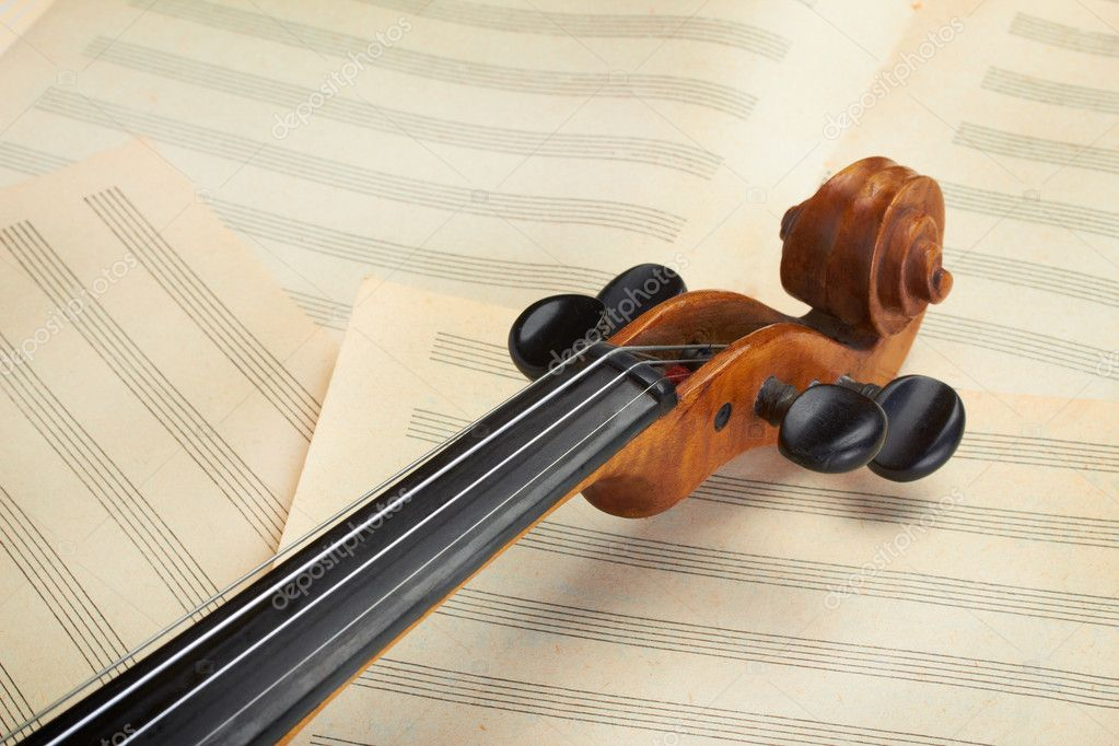Violin neck on old sheets — Stock Photo #11830493