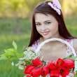 Beautiful girl with tulips outdoor — Stock Photo