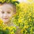 Stock Photo: Smile girl in rape field