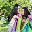 Two girls with colored bags outdoor — 图库照片