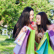 Two girls with colored bags outdoor — Stockfoto