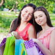 Two girls with colored bags outdoor — Foto Stock