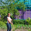Woman doing work in her garden — Стоковое фото