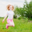 Girl jumping over a skipping rope — Stock Photo #11163625