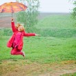图库照片: Happy jumping girl outdoor