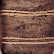 Royalty-Free Stock Photo: Rope on a wooden background