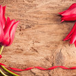 Tulips on wooden background — Stock Photo #11165602