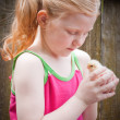 Beautiful girl with little chicken — Stock Photo #11165699