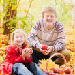 Stock Photo: Brother and sister in autumn garden