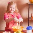 Little girl in the kitchen — Stock Photo #11166060