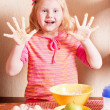 Little girl in the kitchen — Stock Photo #11166065