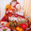 Young family at Christmas dinner table — Stock Photo