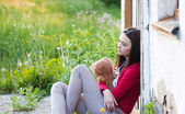 Teenage girls with toy outdoor — Stock Photo
