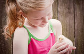 Beautiful girl with little chicken — Stock Photo