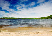 Sandy shore of a large lake — Stock Photo