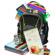 Backpack full of school supplies — Stock Photo