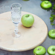 Green ripe apples in water and crystal glass — Stock Photo #11560133