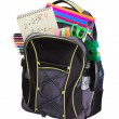Schoolbag with supplies - Stock Photo
