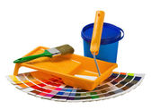 Plastic can with paint, roller, brushes and bright — Stock Photo