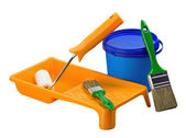 Plastic cans of paint and painting tools — Stock Photo