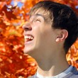 Teenager rejoices autumns — Stock Photo
