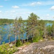 Rocky forest lake — Stock Photo #11453671