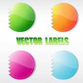 Set of four multicolored round labels — Stock Vector